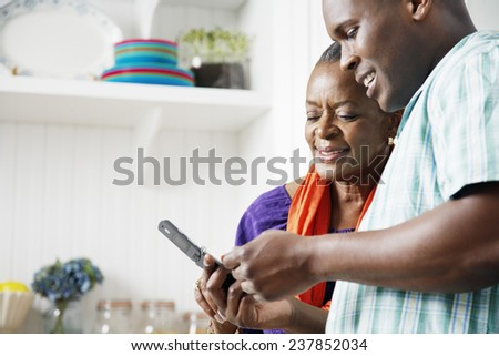 Mother and Son Using Cell Phone - stock photo