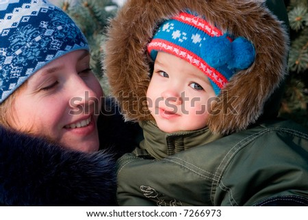 Mother and son walking - stock photo
