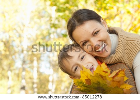 Mother and son walking in a park