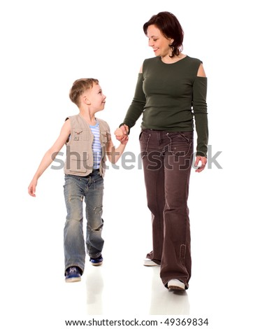 Mother and son walking together isolated on white - stock photo