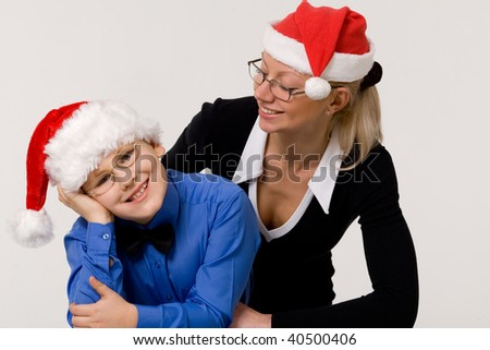 Mother and son wearing red christmas hats