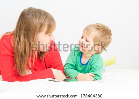 mother and son with touch pad at home, family leisure - stock photo