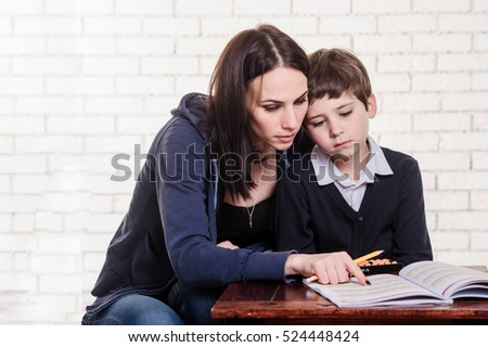 Mother and son work with abacus.