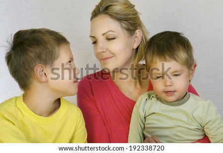 Mother and sons looking happy  - stock photo
