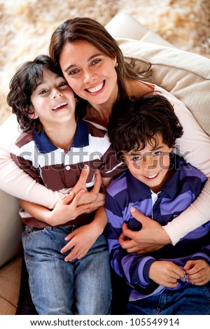 Mother and sons looking happy and smiling - stock photo
