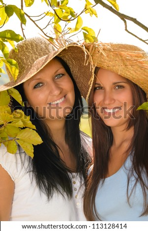 Mother and teen daughter relaxing outdoors happy summer bonding vacation - stock photo