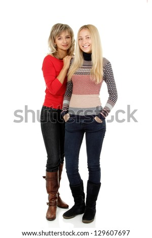 Mother and teen daughter winter portrait over white
