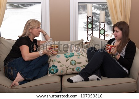 Mother and teenage daughter having a conversation - stock photo