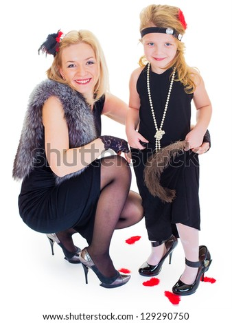 mother and the daughter of the woman of fashion isolated on a white background