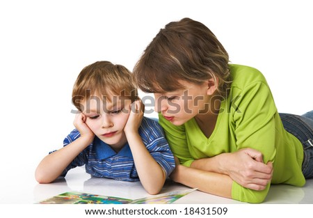 Mother and the son together read the book - stock photo