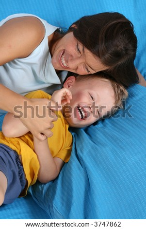 mother and three years old boy in bedroom
