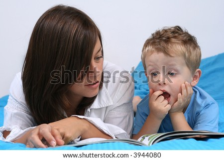 mother and three years old boy reading book - good night