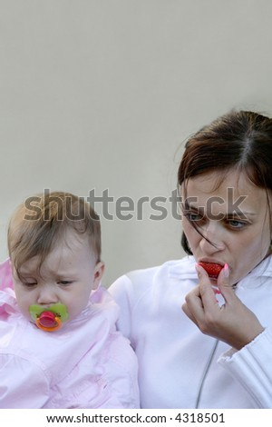 mother and tired baby with dummy - stock photo
