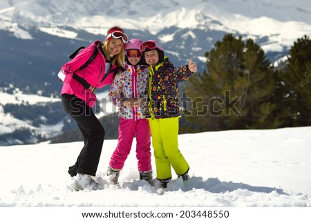 Mother and two daughters enjoyed a winter vacation in the ski resort. Photo shows a cheerful smile on the faces of people having a rest.