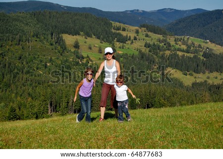 Mother and two kids having fun outdoors