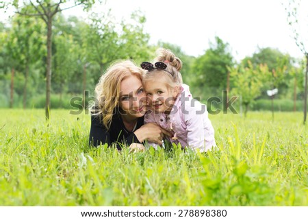 Mother and young daughter in countryside