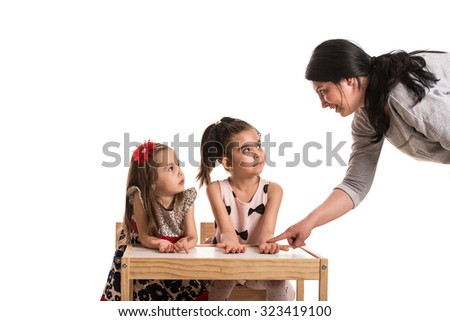 Mother asking her daughters if washed their hands before dinner - stock photo