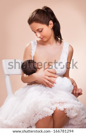 mother breast feeding her child - stock photo