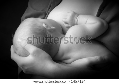 mother breast feeding newborn baby - stock photo