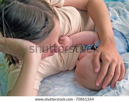 mother breastfeeding her baby - stock photo