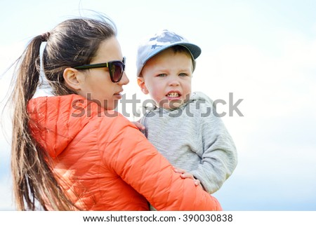 mother calming her crying  toddler son down - stock photo
