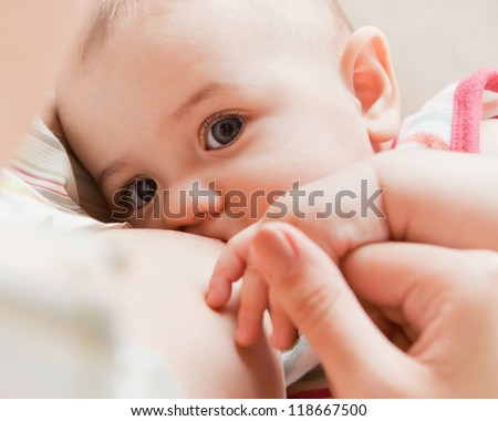 Mother care. Breast feeding baby. - stock photo
