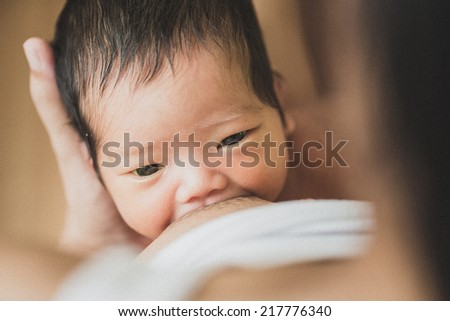 Mother care. Breast feeding baby - stock photo