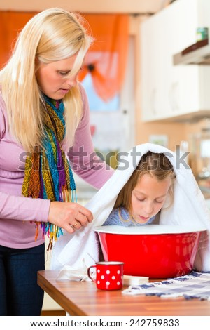 Mother care for sick child with vapor bath at domestic kitchen