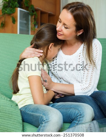 Mother comforting crying little daughter at home  - stock photo