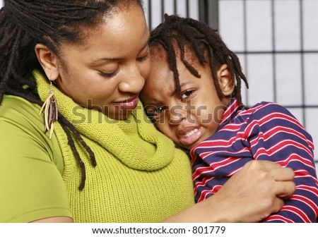 Mother comforts are crying son - stock photo
