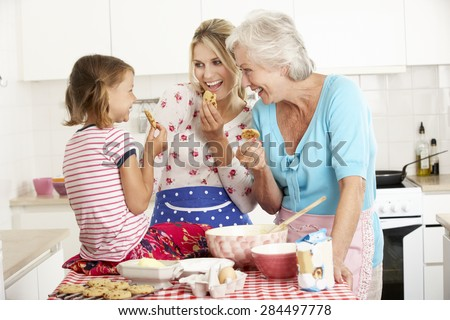 Mother,Daughter And Grandmother Baking In Kitchen - stock photo