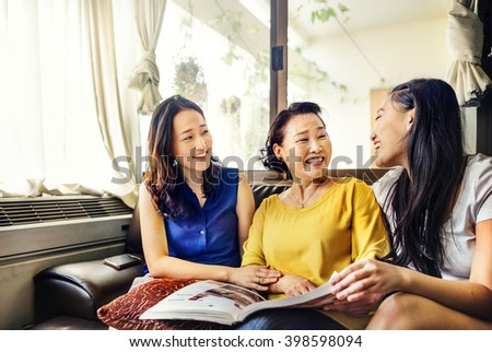 Mother Daughter Happiness Reading Activity Concept - stock photo