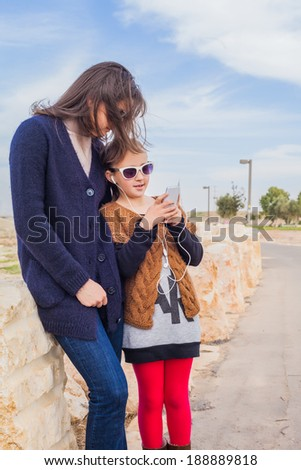 mother daughter on a summer day walk - stock photo
