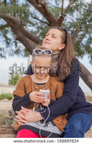 mother daughter on family outing a summer day - stock photo