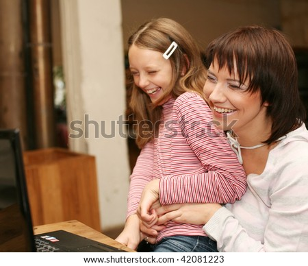 mother & daugther looking at compute.happy family.