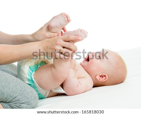 mother doing gymnastics her baby boy infant - stock photo
