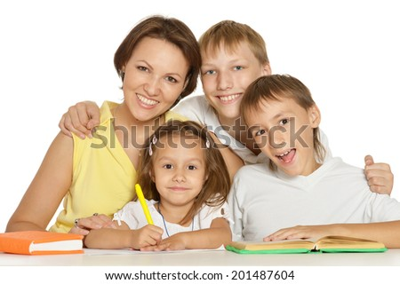 Mother doing homework with her children on a white background  - stock photo