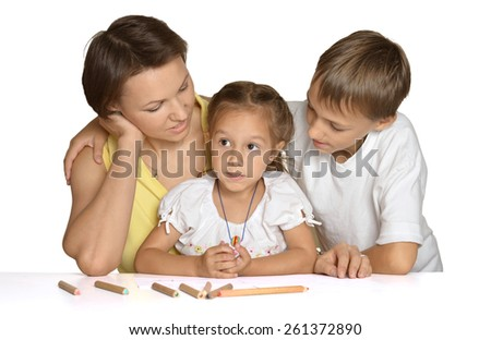 Mother doing homework with her cute children - stock photo