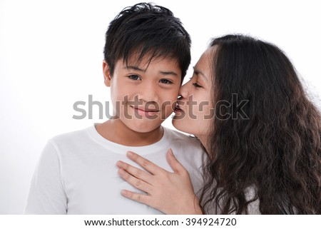 mother embarce her son on white background - stock photo