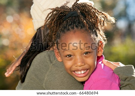 Mother Embracing Daughter - stock photo