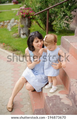 mother embracing her cute daughter - stock photo
