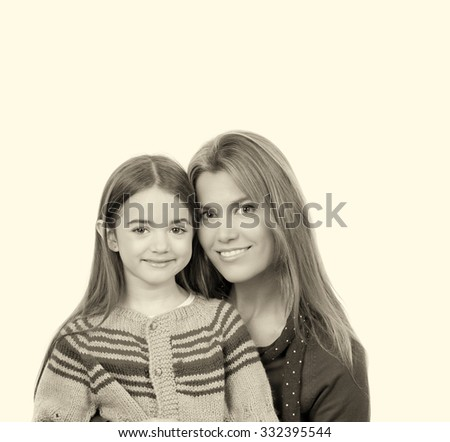 Mother embracing her daughter, isolated on white.