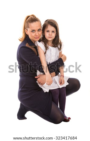 Mother embracing her daughter isolated on white background - stock photo