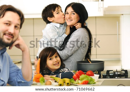 Mother, Father  And Children Prepare A meal,mealtime Together
