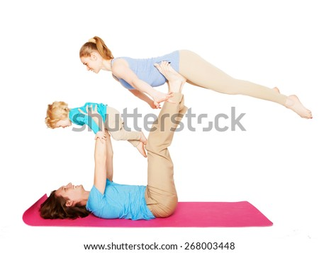 mother, father and son doing yoga over white background - stock photo