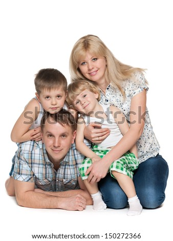 Mother, father and two sons are on the white background