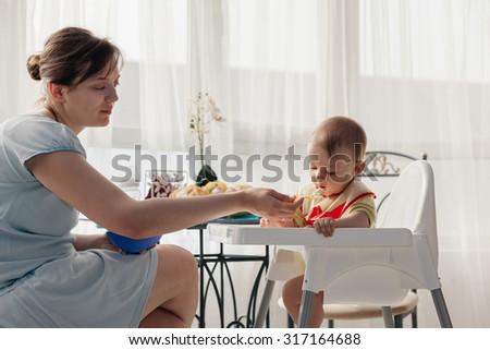 Mother Feeding Adorable Baby Boy  - stock photo