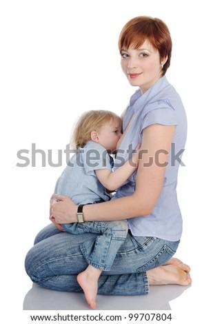 mother feeding baby boy. isolated on white background - stock photo