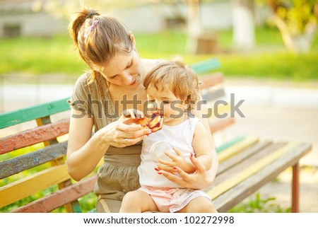Mother feeding baby food - stock photo