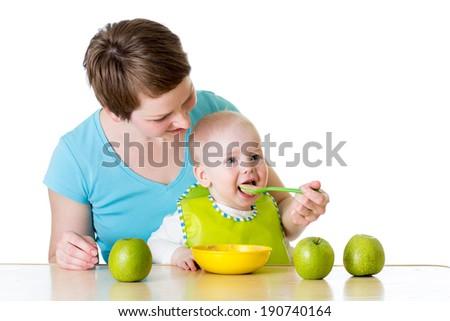 mother feeding her baby boy - stock photo